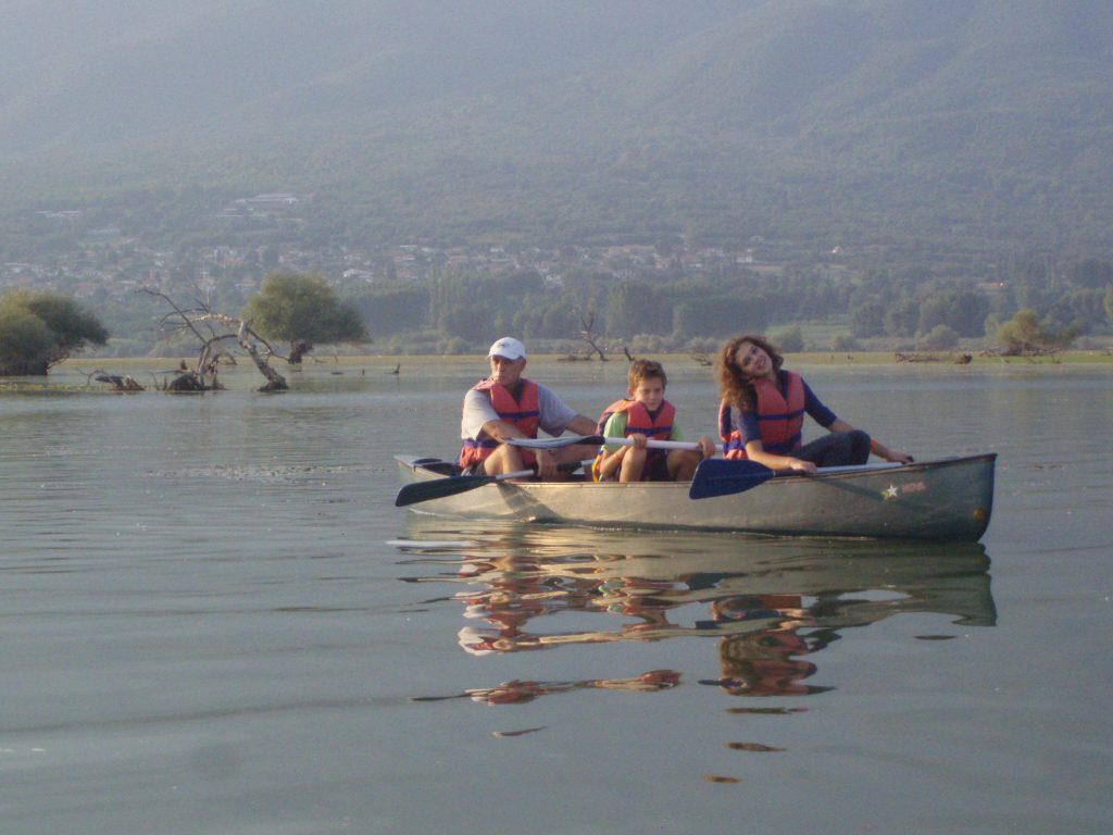 boat on lake with three people